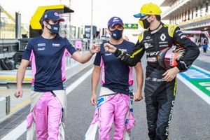 Lance Stroll, Racing Point, Sergio Perez, Racing Point, and Esteban Ocon, Renault F1, in the pit lane