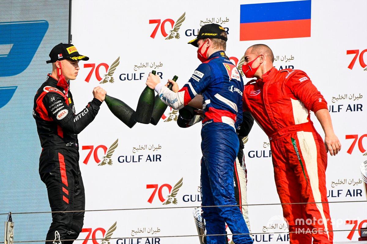 Nikita Mazepin, Hitech Grand Prix, Race Winner Robert Shwartzman, Prema Racing and Winning Constructor Representative celebrate on the podium with the champagne