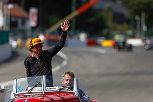 Fernando Alonso, McLaren, in a BMW on the drivers' parade