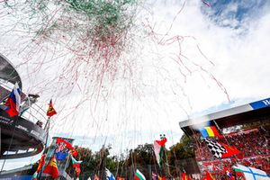 Streamers and confetti fall as the crowd and drivers celebrate at the podium ceremony