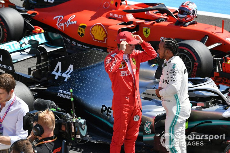 Charles Leclerc, Ferrari, talks with pole man Lewis Hamilton, Mercedes AMG F1