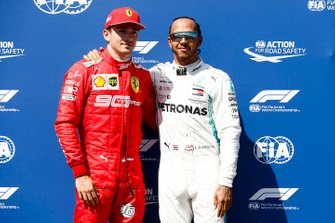 Charles Leclerc, Ferrari, and pole starter Lewis Hamilton, Mercedes AMG F1