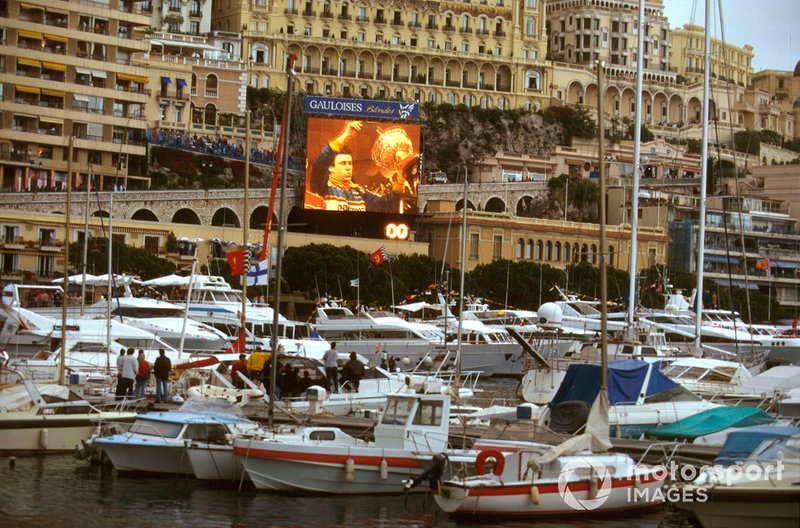 Race winner Olivier Panis, Ligier JS43 captured on the big screen by the harbour