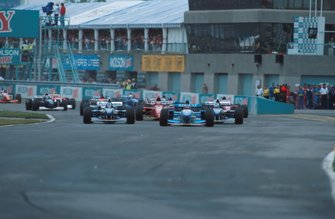 Johnny Herbert, Benetton leads at the start of the race