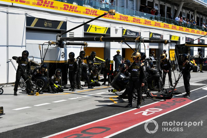 The Haas F1 pit crew prepared for a stop