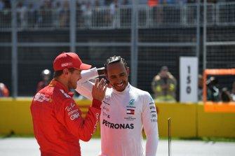Pole man Sebastian Vettel, Ferrari, with Lewis Hamilton, Mercedes AMG F1, after Qualifying