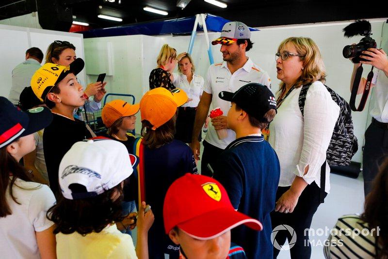 Carlos Sainz Jr., McLaren, signs autographs for young fans