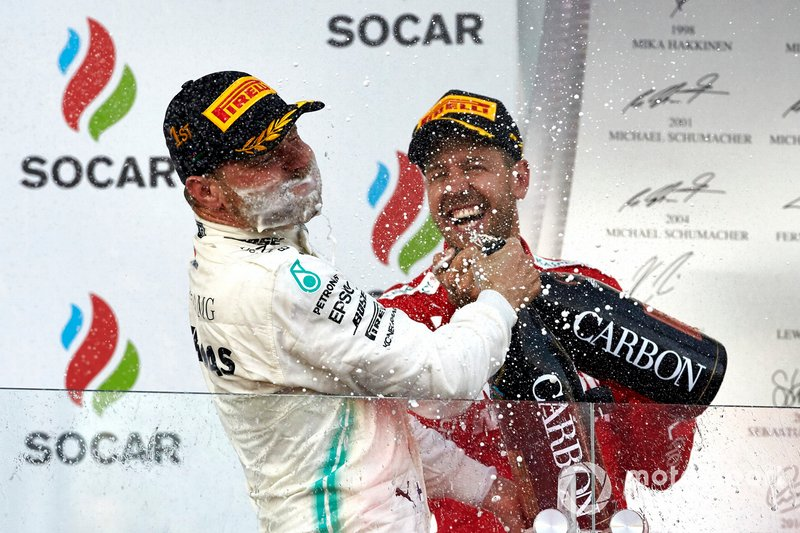 Valtteri Bottas, Mercedes AMG F1, 1st position, sprays himself with Champagne as Sebastian Vettel, Ferrari, 3rd position, joins in