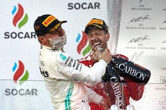 Valtteri Bottas, Mercedes AMG F1, 1st position, sprays himself with Champagne as Sebastian Vettel, Ferrari, 3rd position, joins in