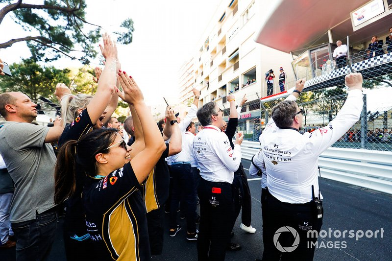 The DS TECHEETAH team celebrate victory below the podium