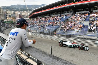 Sergio Perez, Racing Point, watches Lewis Hamilton, Mercedes AMG F1 W10, in qualifying