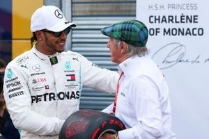 Lewis Hamilton, Mercedes AMG F1, celebrates pole position, and is presented with the Pirelli Pole Trophy by Jackie Stewart