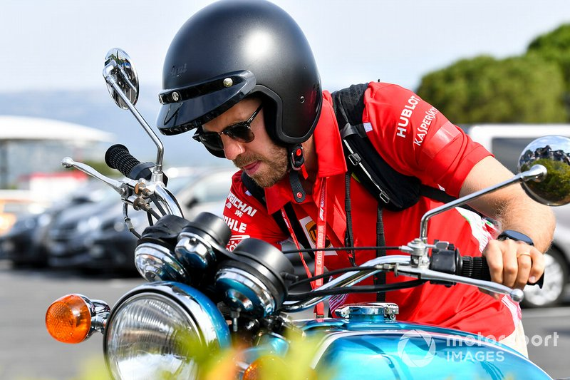 Sebastian Vettel, Ferrari arrives on his motorbike