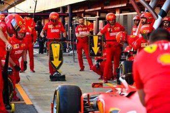 The Ferrari team practice a pit stop