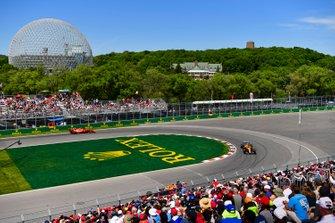 Lando Norris, McLaren MCL34, leads Charles Leclerc, Ferrari SF90