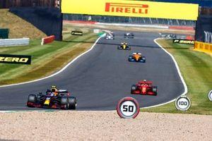 Alex Albon, Red Bull Racing RB16 and Charles Leclerc, Ferrari SF1000