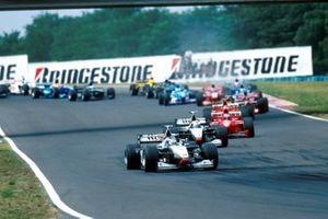 Mika Hakkinen, McLaren MP4-13 leads the field