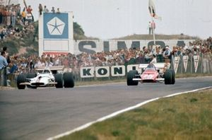 George Eaton, BRM P153, is passed by Jacky Ickx, Ferrari 312B