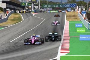 Lance Stroll, Racing Point RP20, leads Valtteri Bottas, Mercedes F1 W11 EQ Performance, and Sergio Perez, Racing Point RP20