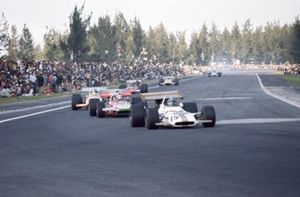Pedro Rodriguez, BRM P153, leads Chris Amon, March 701 Ford and Denny Hulme, McLaren M14A Ford