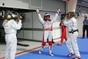 Jarno Trulli, Toyota celebrates his pole position in parc ferme