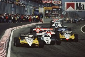 Rene Arnoux, Renault RE30B, leads Keke Rosberg, Williams FW08 Ford, Alain Prost, Renault RE30B, and Niki Lauda, McLaren MP4-1B Ford, at the start