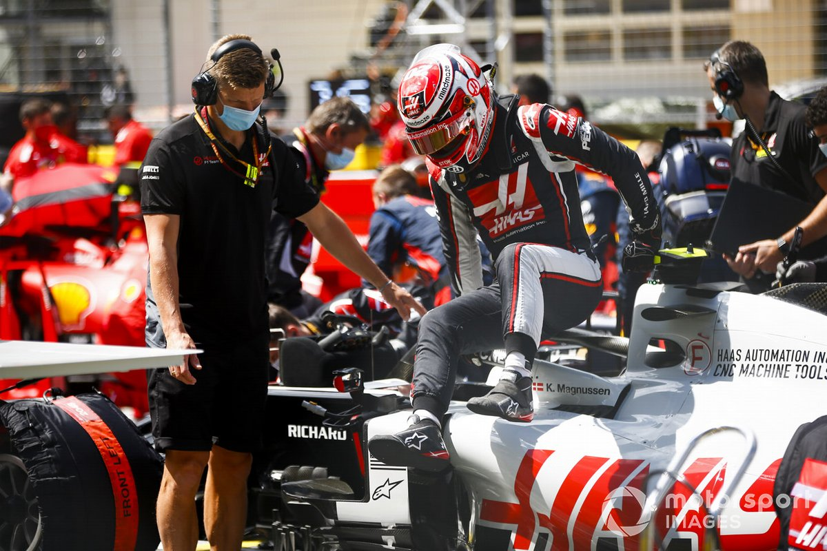 Kevin Magnussen, Haas F1, climbs out of his car on the grid