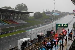 The cars in the pit lane with the session red flagged