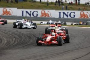 Felipe Massa, Ferrari F2008, leads Lewis Hamilton, McLaren MP4-23 Mercedes and Robert Kubica, BMW Sauber F1.08
