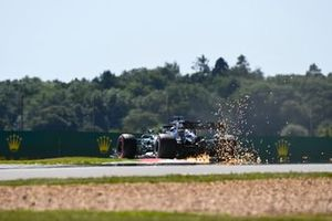 Sparks fly from the rear of Lewis Hamilton, Mercedes F1 W11