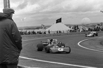Jackie Stewart, Tyrrell 003 Ford leads Jacky Ickx, Ferrari 312B2 and Denny Hulme, McLaren M19A Ford