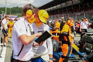Lando Norris, McLaren, on the grid with his engineer