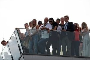 Fans watch the podium ceremony from a balcony