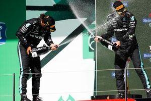 Lewis Hamilton, Mercedes, 1st position, and Valtteri Bottas, Mercedes, 3rd position, spray Champagne on the podium