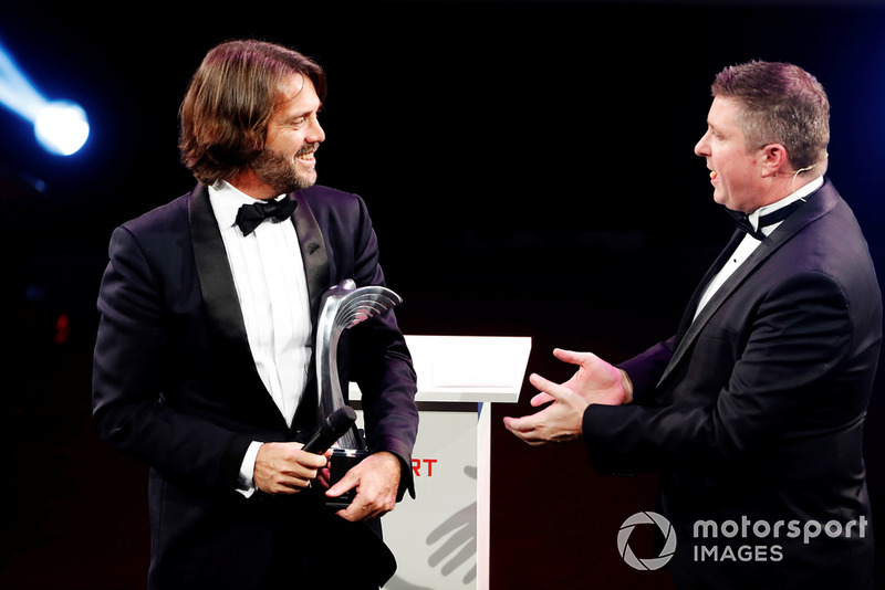Stephane Ratel is presented with a Gregor Grant Award on stage