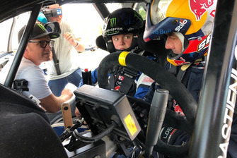 Sebastien Loeb tutoring Oliver Solberg, with Petter Solberg watching on