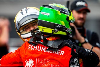 Helio Castroneves hugs Mick Schumacher