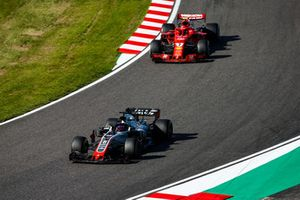Romain Grosjean, Haas F1 Team VF-18, leads Kimi Raikkonen, Ferrari SF71H