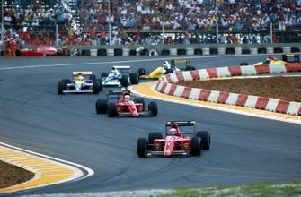 Winner Alain Prost, Ferrari 641 leads Nigel Mansell, Ferrari 641 and Riccardo Patrese, Williams Renault FW13B