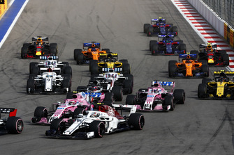 Charles Leclerc, Sauber C37, leads Esteban Ocon, Racing Point Force India VJM11, Sergio Perez, Racing Point Force India VJM11, Sergey Sirotkin, Williams FW41, Marcus Ericsson, Sauber C37, Carlos Sainz Jr., Renault Sport F1 Team R.S. 18, Nico Hulkenberg, Renault Sport F1 Team R.S. 18, Fernando Alonso, McLaren MCL33, and the remainder of the field at the start of the race
