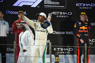 Lewis Hamilton, Mercedes AMG F1 celebrates with the trophy on the podium