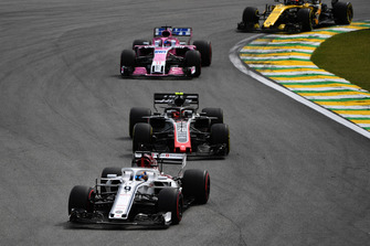 Marcus Ericsson, Sauber C37 leads Kevin Magnussen, Haas F1 Team VF-18 Kevin Magnussen, Haas F1 Team VF-18 and Sergio Perez, Racing Point Force India VJM11