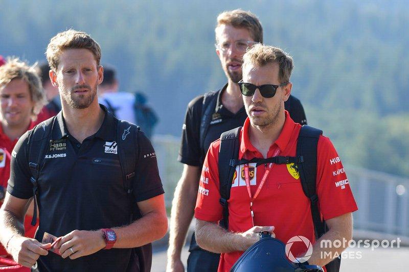 Romain Grosjean, Haas F1, e Sebastian Vettel, Ferrari