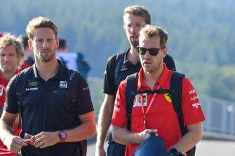 Romain Grosjean, Haas F1, and Sebastian Vettel, Ferrari