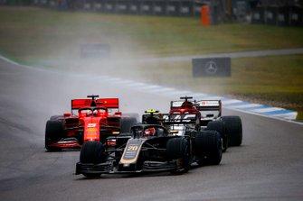 Kevin Magnussen, Haas F1 Team VF-19, leads Kimi Raikkonen, Alfa Romeo Racing C38, and Sebastian Vettel, Ferrari SF90