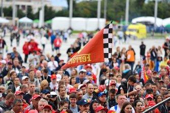 A fan holds a Ferrari flag