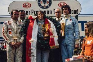 Подиум: победитель Гран При Германии Джеки Стюарт, второе место – Франсуа Север, Tyrrell, третье место – Клей Регаццони, Ferrari