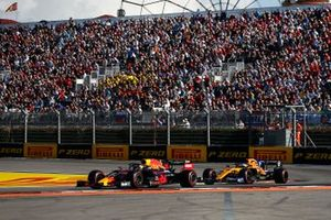 Max Verstappen, Red Bull Racing RB15, leads Carlos Sainz Jr., McLaren MCL34