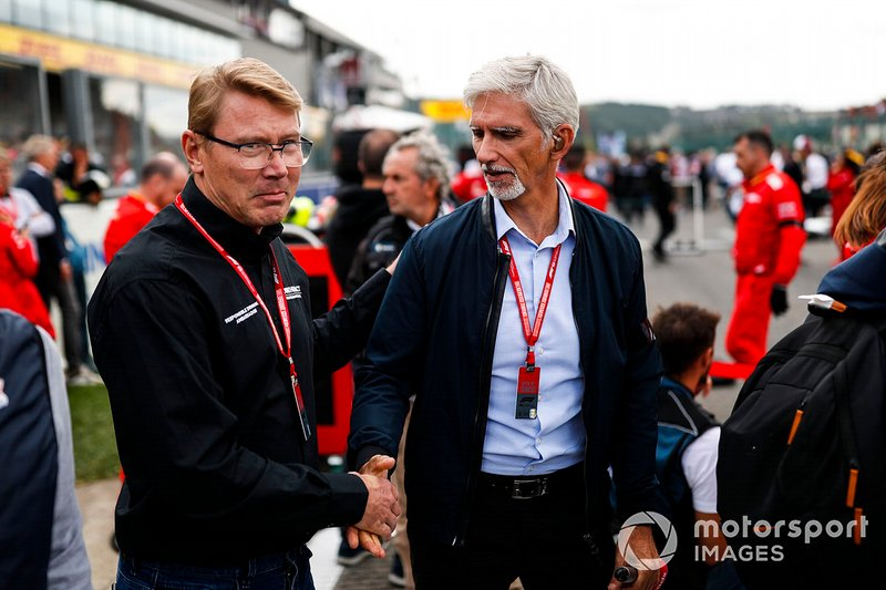 Former world champions Mika Hakkinen and Damon Hill on the grid