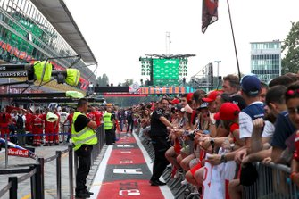 Atmosphere in the pitlane with fans